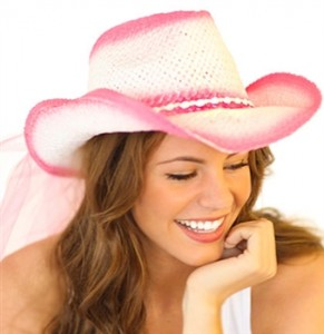pink and white straw western hat and veil